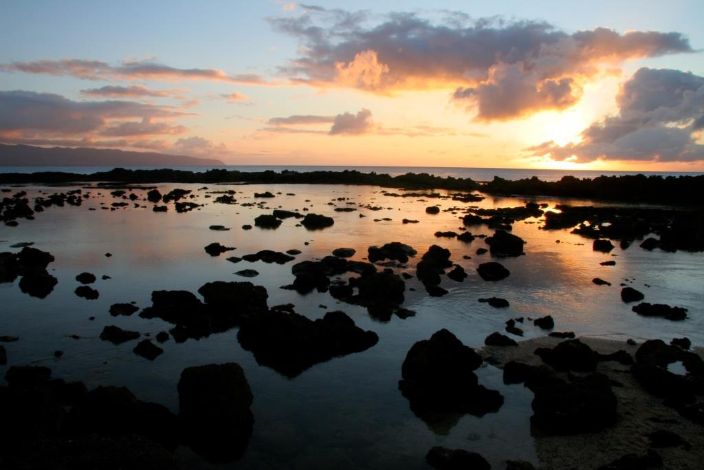 Sunset_over_Sharks_Cove,_North_Shore_Oahu_Hawaii
