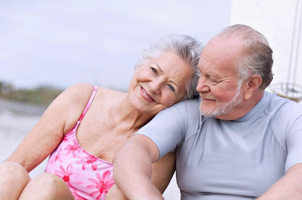 Smiling Senior Couple at Beach --- Image by © Stephen Beaudet/Corbis