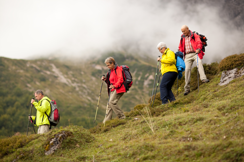 senior hiking group in steep terrain
